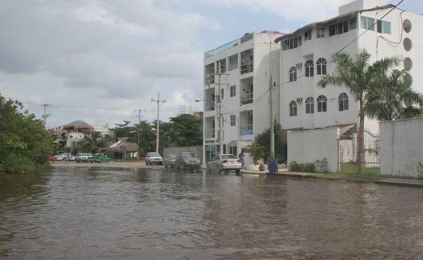 Las incesantes lluvias han provocado graves inundaciones en varias zonas de Puerto Morelos. (Foto de Archivo/SIPSE)
