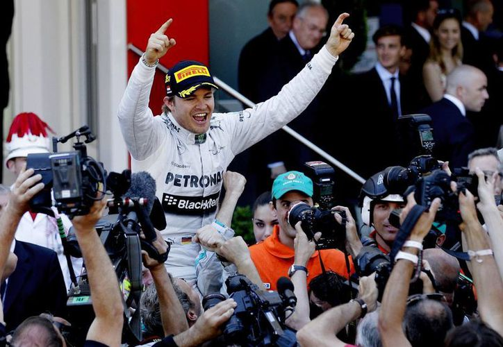 Rosberg finalizó por delante de su compatriota y líder del campeonato, Sebastian Vettel y de Mark Webber, de Red Bull. (Agencias)