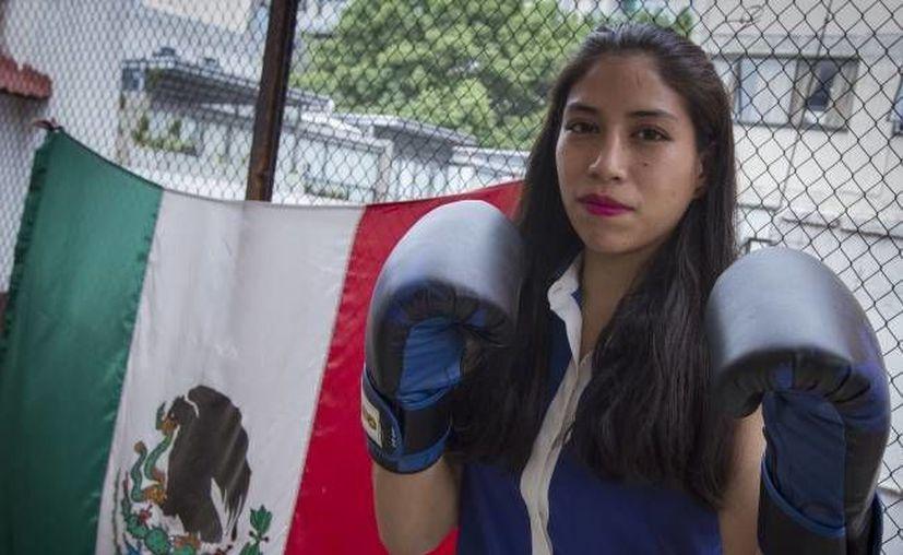 Victoria Torres; Boxeadora mexicana, dice que su sueño es competir en los juegos Olímpicos de Rio 2016 y esa será su motivación para dar lo mejor en sus enfrentamientos (NOTIMEX/ Jessica Espinosa)