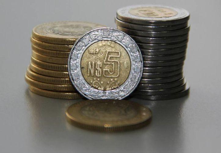 La Corporación Financiera Internacional estima que el tipo de cambio fluctúe entre los 18 y 19 pesos por dólar por el resto del año. (Archivo/Notimex)
