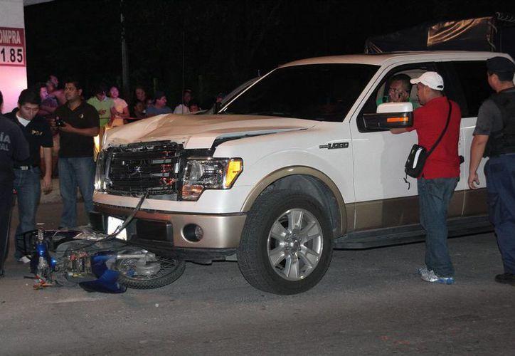La camioneta del tesorero Edwin Argüelles era conducida por uno de sus escoltas. (Julián Miranda/SIPSE)