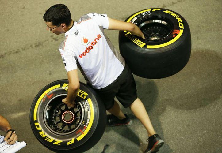 McLaren logró el récord de cambio de gomas en el pasado Gran Premio de Alemania al requerir sólo 2.3 segundos en el auto de Button. (Foto: Agencias)