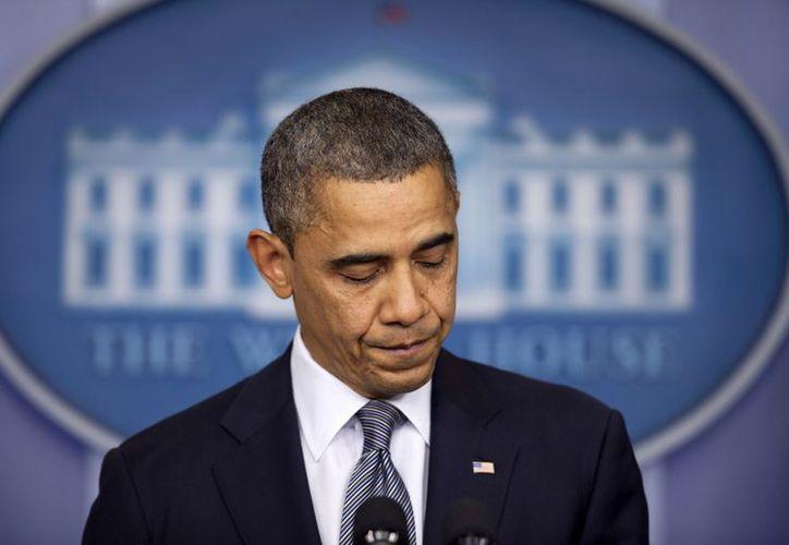 El Presidente telefoneó al gobernador de Connecticut para enviar sus condolencias a las familias de las víctimas del tiroteo. (Agencias)