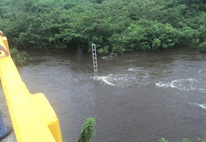 Familias de la ribera del Río Hondo han comenzando ha ser desalojadas de sus viviendas. (Archivo/SIPSE)