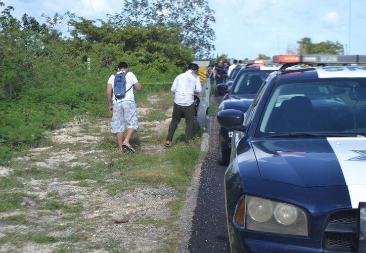 Policías federales se encargaron de acordonar el área, mientras que paramédicos atendieron a los lesionados. (Foto: Redacción/SIPSE)