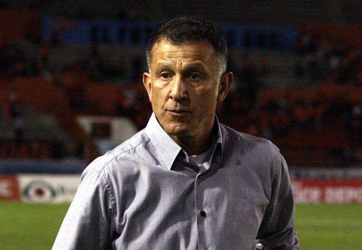 Juan Carlos Osorio, virtual técnico de la Selección Mexicana, tiene un 'negro' pasado con el equipo de La Franja de Puebla. (Archivo/Jammedia)