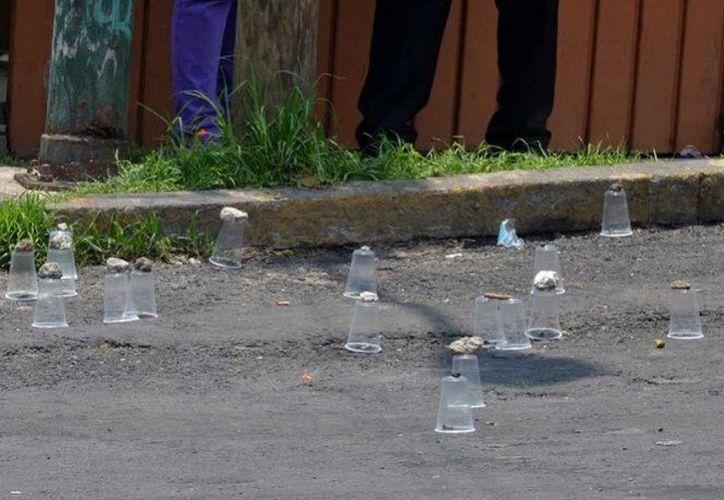Los cuerpos fueron hallados a las orillas de la carretera que conecta a Naupan con Huauchinango. (Twitter)