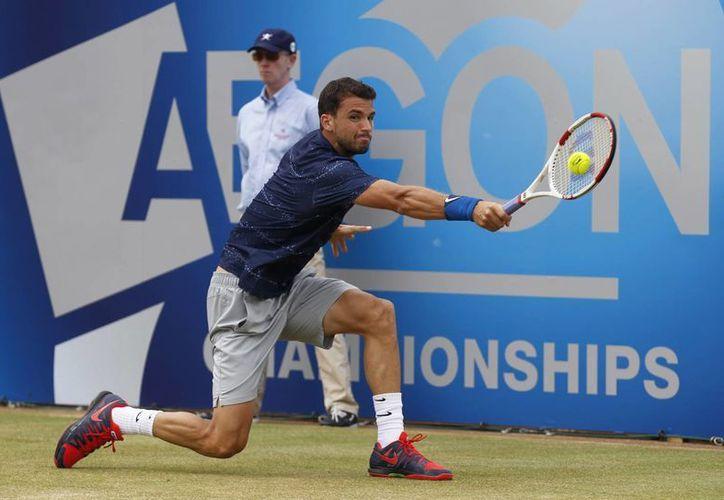 Dimitrov, de 23 años, es el tenista más joven entre de los 20 mejores del mundo. (EFE)