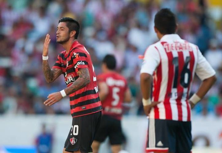 Aunque el equipo del Guadalajara (derecha) anda de 'capa caída' en la liga, su afición ayuda a damnificados. (Agencias/Foto de contexto)