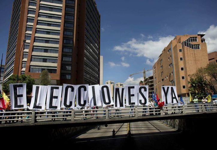 Este martes se realizó la primera protesta 'sorpresa' convocada por la oposición venezolana. (AP Photo/Ariana Cubillos)