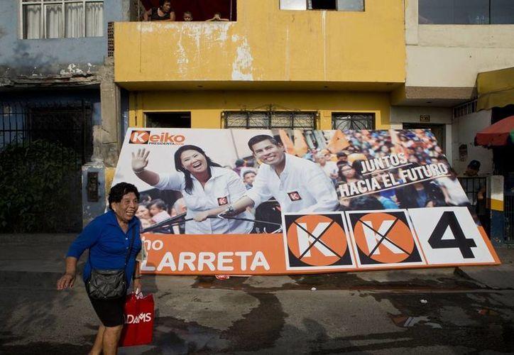 Keiko Fujimori podría ser la próxima presidenta de Perú, país en donde el voto es obligatorio. (AP)
