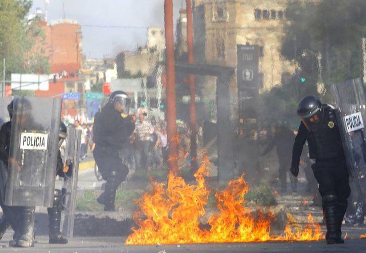 Imagen de disturbios en la Ciudad de México después de manifestaciones ciudadanas por el caso Ayotzinapa. (Archivo/SIPSE)