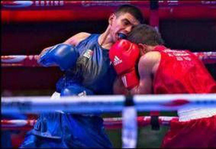 El buen desempeño del pugilista le valió para quedarse con la medalla de bronce en la justa deportiva. (Foto/Internet)