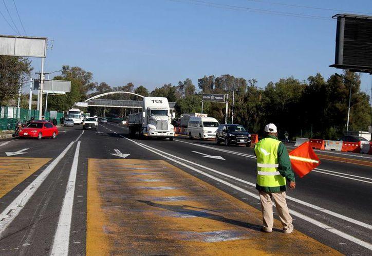 Entre las mejoras a la infraestructura de Michoacán se contemplan trabajos en los 52 kilómetros comprendidos entre las autopistas México-Querétaro y la México-Morelia. (Notimex/Archivo)