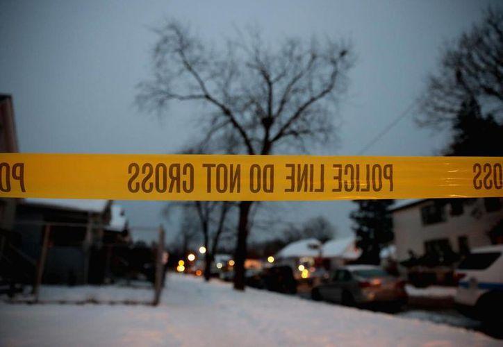 Un pistolero solitario mató a dos personas e hirió a otras cinco que se encontraban en una reunión familiar el domingo, en Chicago. (ABC News)
