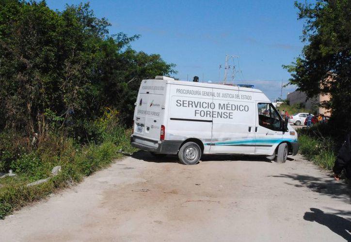 El cuerpo del joven fue encontrado en un área verde, estaba envuelto con una cobija y atado con un  cable de tendedero. (Archivo/SIPSE)