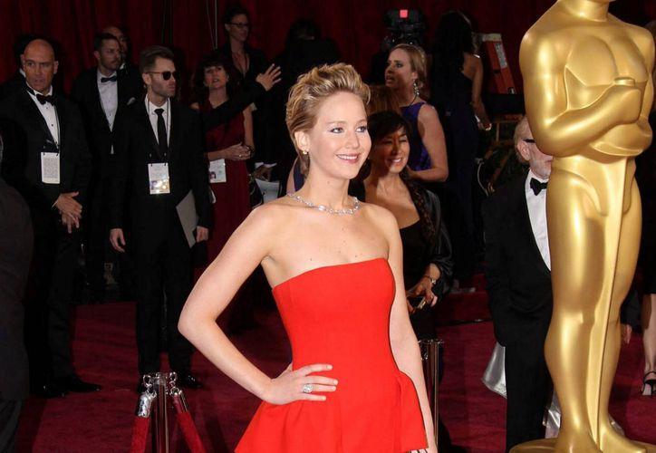 Según Forbes, las ganancias de Jennifer Lawrence aumentaron gracias a Los Juegos del Hambre, Sinsajo. (Archivo/Notimex)