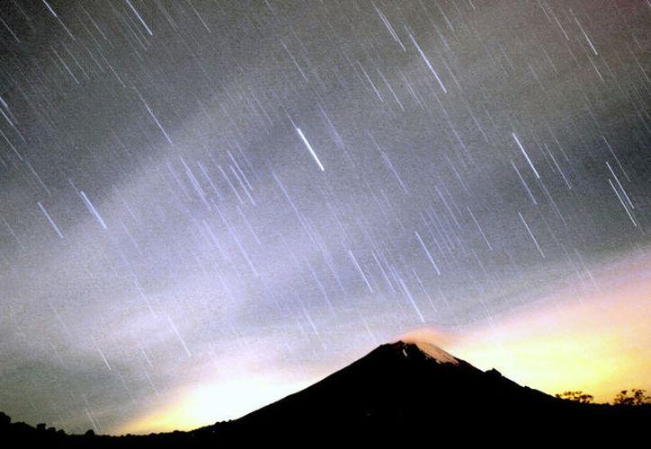 Lluvias de estrellas es un fenómeno que tiene su origen cuando el planeta Tierra pasa por la órbita de un cometa. (Foto: RT)