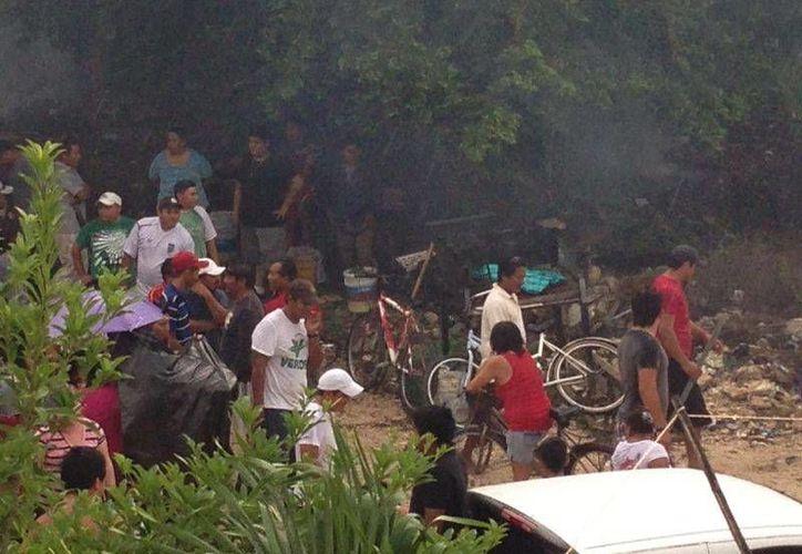 Otro grupo de personas intentó invadir un terreno propiedad del Ipae. (Rossy López/SIPSE)