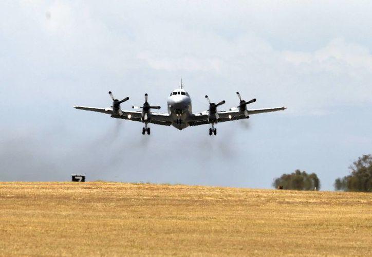 Un avión de la Real Fuerza Aérea australiana se une a la búsqueda del avión de Malaysia Airlines desaparecido. (Agencias)