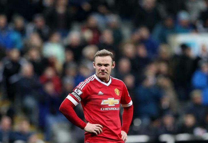 Wayne Rooney fue el autor de un doblete y dio una asistencia este martes durante el partido del Manchester United contra el Newcastle, en la jornada 21 de la Premier League. (AP)