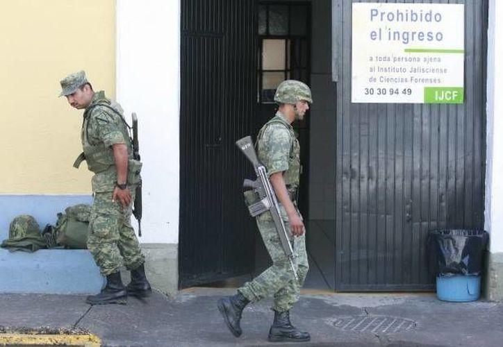 En el marco del arresto de <i>El Menchito</i>, militares catearon al menos dos predios en Zapopan, uno en la colonia Prados Vallarta y otro en la colonia Jardines de la Patria. (Agencias/Contexto)