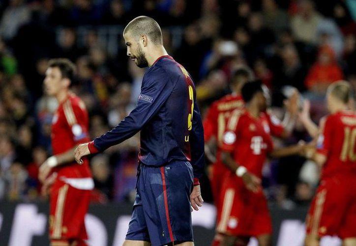 El defensa central balugrana Gerard Piqué tuvo la mala suerte de anotar un autogol en el juego de vuelta. (EFE)