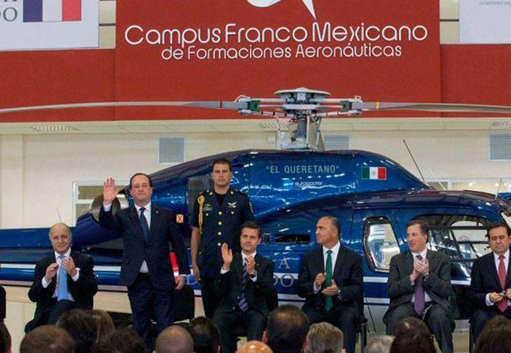 Los presidentes de Francia, Francois Hollande, y de México, Enrique Peña Nieto, encabezaron la apertura del Campus Aeronáutico Franco-Mexicano, en Querétero. (presidencia.com.mx)