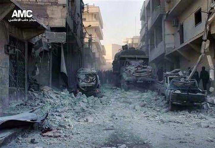 Foto de periodismo ciudadano del lunes 23 de diciembre de 2013 proporcionada por el Aleppo Media Center, cuya autenticidad ha sido verificada en base a su contenido y otras labores noticiosas de la AP. (Foto AP/Aleppo Media Center AMC)