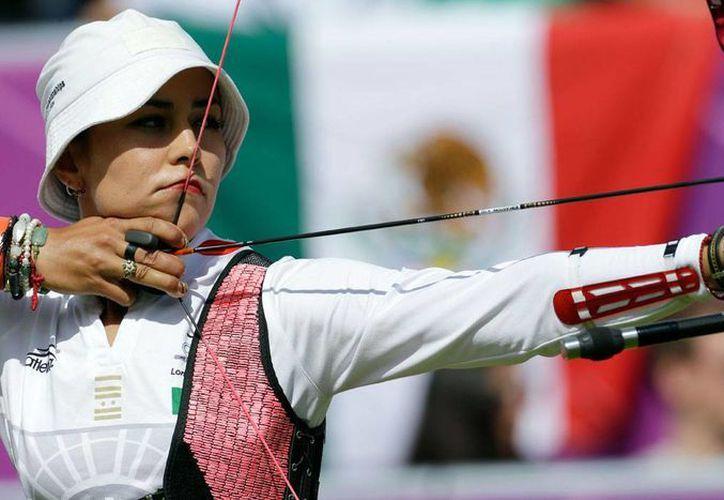 Aída Román quedó en primer lugar en la ronda preliminar en Shangai, seguida de dos colombianas. (Foto: AP)