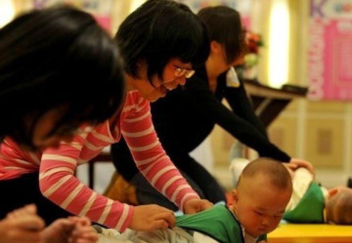 Una propuesta publicada en un boletín oficial de la provincia de Jiangsu propone abolir la limitación de dos hijos y sancionar si no se procrea. (Foto: Contexto)