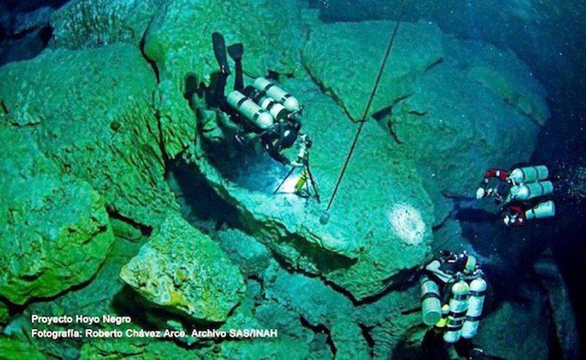 En el 'Hoyo Negro' (foto) se encontraron restos con más de 13 mil años. Mientras en Yucatán, en el cenote San Manuel de Tizimín, se encontraron restos óseos y materiales prehispánicos.  (Cortesía)