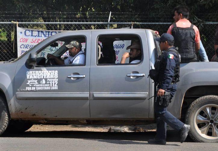Autodefensas en Tancítaro, Michoacán. (Notimex)