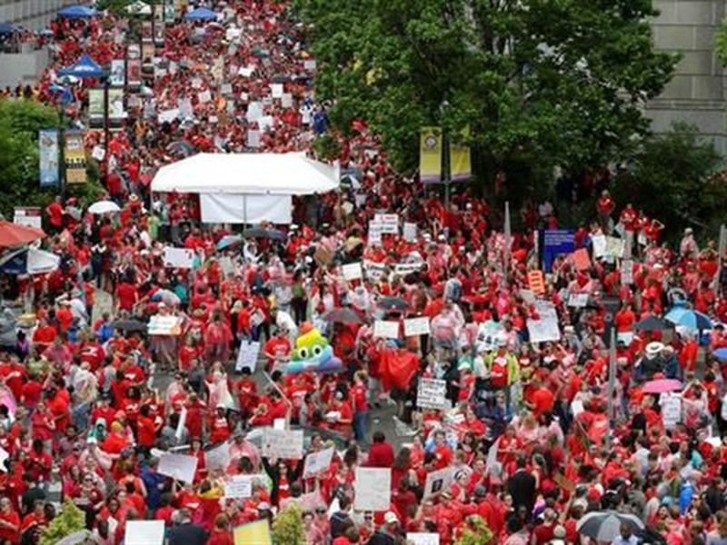 Educators fill Bicentennial Plaza during a teachers rally at the General Assembly in Raleigh, N.C.