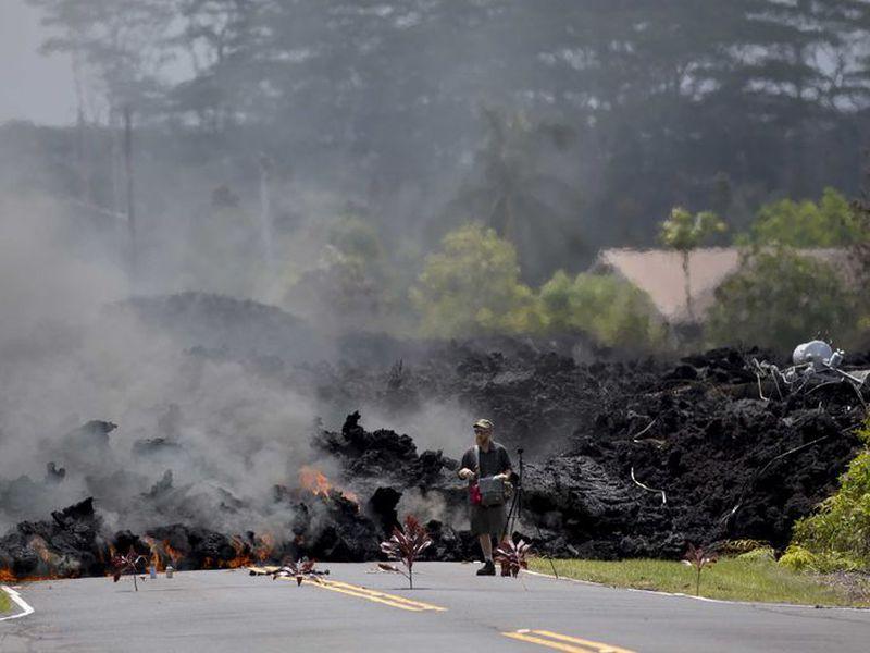 A man films the lava in the Leilani Estates subdivision, in Pahoa, Hawaii. (AP)