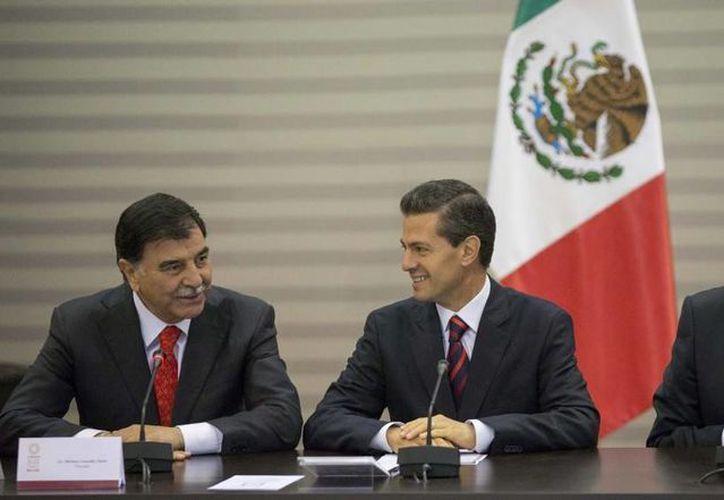 El presidente Peña Nieto asistió al nombramiento de Eruviel Ávila Villegas, gobernador del Estado de México, como nuevo titular de la Conago.  (Presidencia)