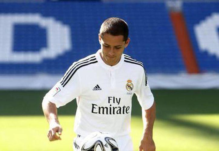 Además de entrenar con el Real Madrid, 'Chicharito' Hernández ya conoció la que será su habitación de residencia. (Notimex)