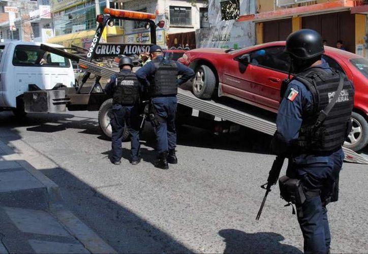 Los uniformados que dispararon contra la automovilista creyeron que era un delincuente. (Notimex/Contexto)