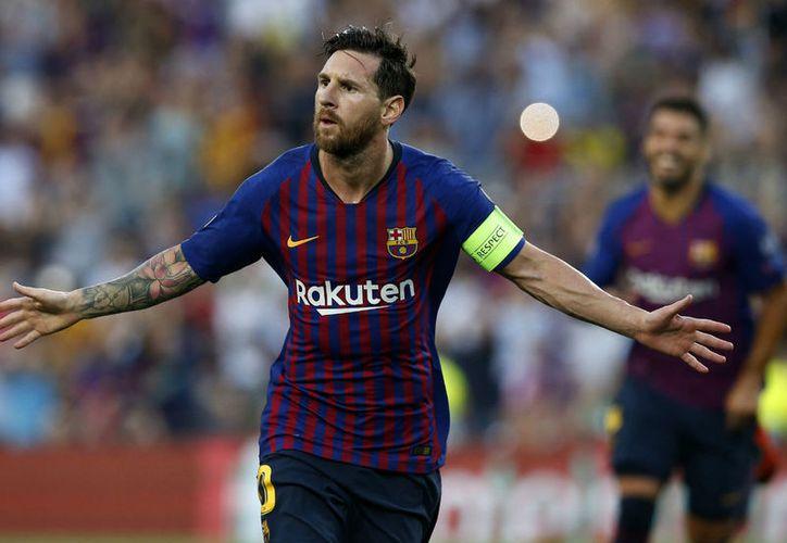 Con tres de los cuatro goles, Leonel Messi hace ganar al Barça contra PSV. (Foto: AP)