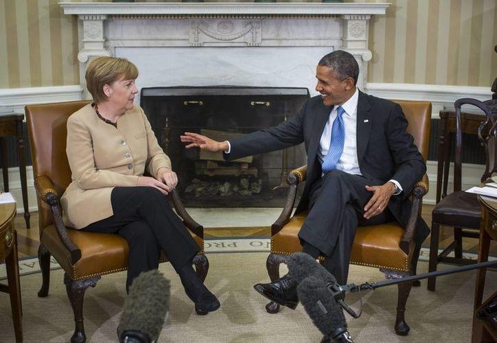 El presidente estadounidense Barack Obama durante su encuentro con la canciller alemana Angela Merkel celebrado en la Casa Blanca, Washington, Estados Unidos. (EFE)