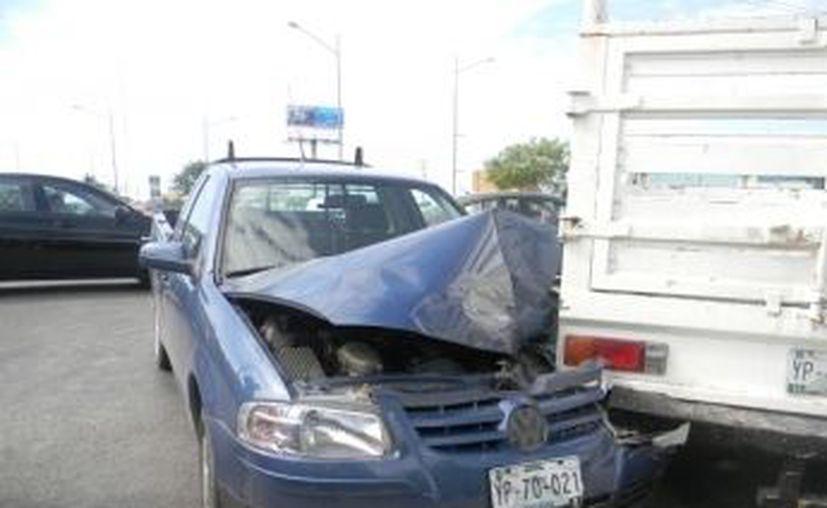Choque entre dos camionetas ocurrido en el cruce del Anillo Periférico con la calle 21 de la colonia Chuburná en noviembre. (SIPSE)