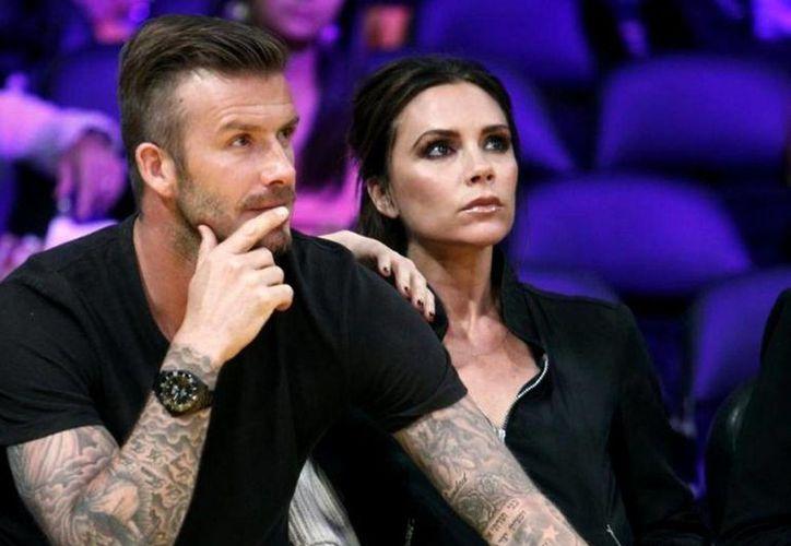David y Victoria Beckham, aunque llevan tatuajues que simbolizan su relación de pareja, son de las parejas más sólidas del mundo del espectáculo. (Agencias)