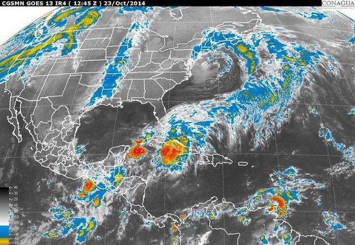 La depresión tropical se ubicará sobre el sur de la Península de Yucatán y mantendrá una amplia zona de nublados densos. (Redacción/SIPSE)
