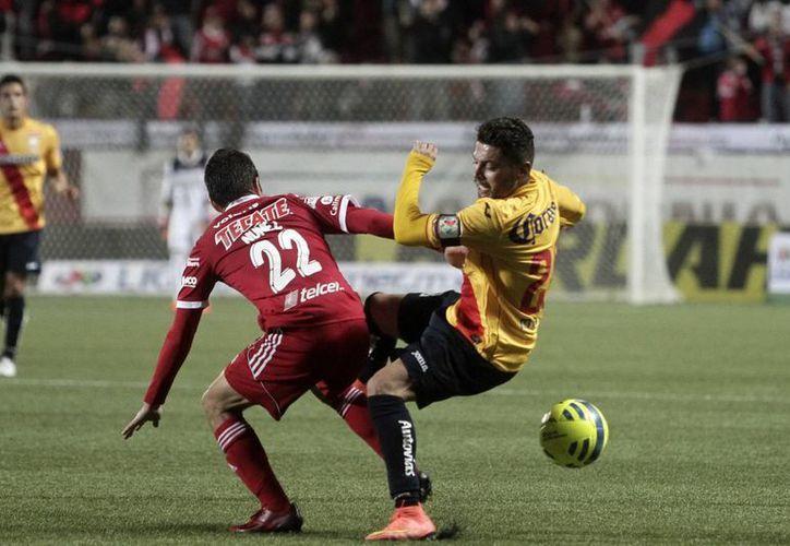 Xolos, que ya no cuenta con su goleador de la temporada pasada, Darío Benedetto, son líderes del Futbol Mexicano gracias a su victoria sobre Monarcas Morelia. (Notimex)