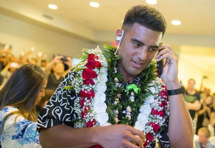 Marcus Mariota quien fue elegido por los Titanes de Tennessee, no asistió a Chicago para el Draft. (Foto: AP)