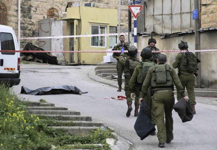 El uso de la fuerza de la milicia israelí ha sido duramente cuestionada tras la muerte 'injustificada' de un palestino herido. (AP)