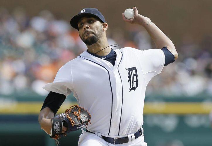 David Price de los Tigres de Detroit lanza en el sexto inning ante los Mellizos de Minnesota. (AP Foto/Carlos Osorio)