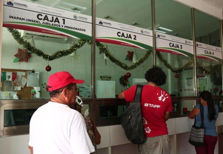 El pago se puede en las cajas del Palacio Municipal. (Redacción/SIPSE)
