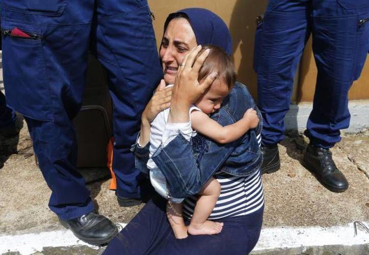 La capital húngara se ha convertido en un punto desde donde cientos de inmigrantes sirios y de otras partes de Oriente Medio buscan un tren que los lleve a otros países del continente. (RT)
