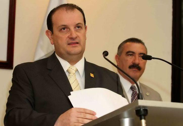 El titular de la PGJDF, Rodolfo Ríos, habló sobre la importancia de las declaraciones del padre de uno de los desaparecidos. (Notimex)